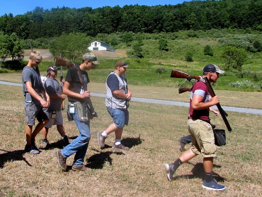 Members of the Troy Junior Sportsmen team walk to a shotgun station during Tuesday's YHEC competition.