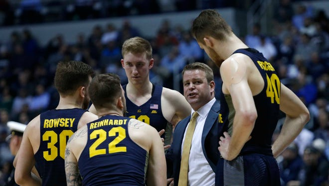 Marquette Golden Eagles head coach Steve Wojciechowski talks to his team during the second half against the Xavier Musketeers at the Cintas Center. Marquette won 95-84.
