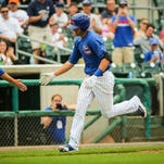 Iowa Cubs third baseman (19) Kris Bryant hits a home run in the fifth inning versus the Albuquerque Isotopes Monday June 23, 2014, at Principal Park. Photo by Rodney White, The (Des Moines) Register ORG XMIT: des.s0623icubsisotopes [Via MerlinFTP Drop]