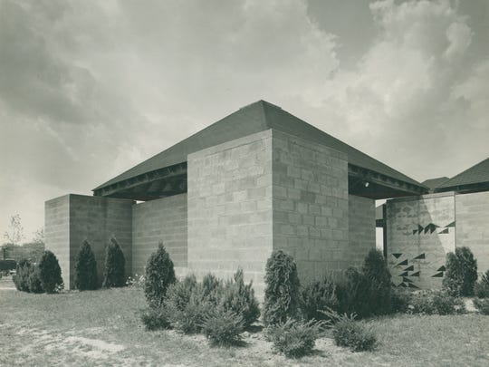 The Jewish Community Center in Ewing Township was designed by Louis Kahn, 1954–59. Here is an exterior view of the Bath House with a wall drawing at the entrance designed by Kahn.