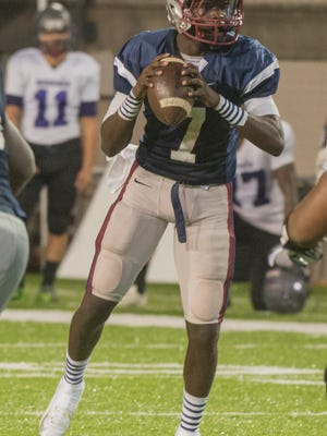 Park Crossing quarterback Malik Cunningham looks for a receiver. Park Crossing lost to Bessemer City 28-24 in the first round of high school playoffs on Friday, Nov. 6, 2015, at Cramton Bowl in Montgomery.