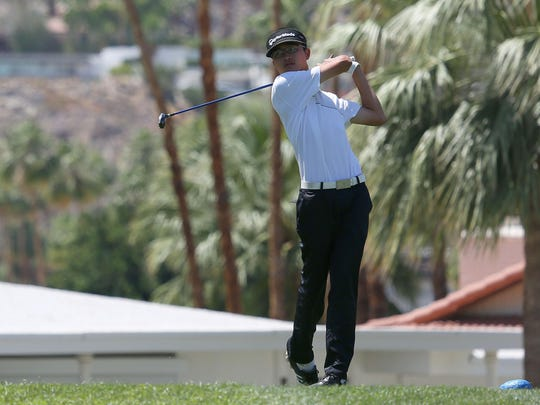 Leo Hsiang of Xavier Prep tees off on the 8th hole at the Indian Canyons North Course in Palm Springs, Tuesday, May 5, 2015.