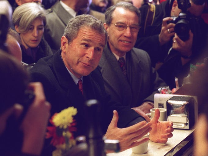 George W. Bush and Sen. Chuck Grassley enjoy conversation