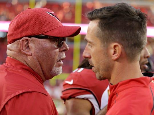 Arizona Cardinals head coach Bruce Arians, left, talks