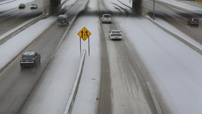 Traffic flows on I-75 by the Vernor Highway exit in Detroit on Sunday, January 26, 2014.