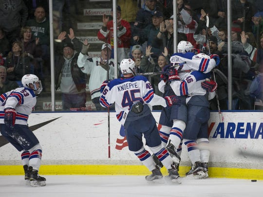 Mobbing each other after scoring the tying goal during Saturday's third period are members of the NTDP Under-17 team.