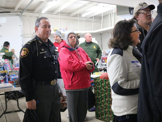 Members of the Ottawa County Sheriff's Office, including Sheriff Steve Levorchick, were among the many volunteers at the Toys for Tots distribution on Wednesday.