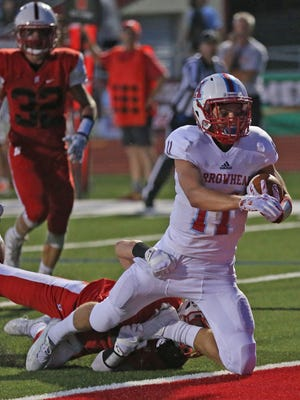 Arrowhead wide receiver Jack Becker scores as he is brought down in the end zone by Homestead's Ben Price. Arrowhead won, 25-18.