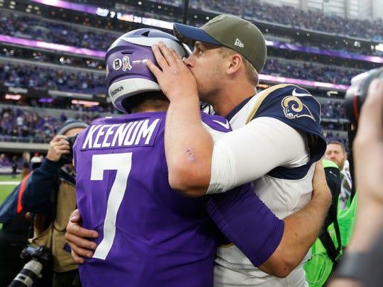 Minnesota Vikings quarterback Case Keenum (7) talks with Los Angeles Rams quarterback Jared Goff after an NFL football game, Sunday, Nov. 19, 2017, in Minneapolis. The Vikings won 24-7. (AP Photo/Bruce Kluckhohn)