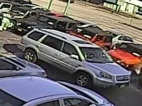 Surveillance video shows a woman in white identified