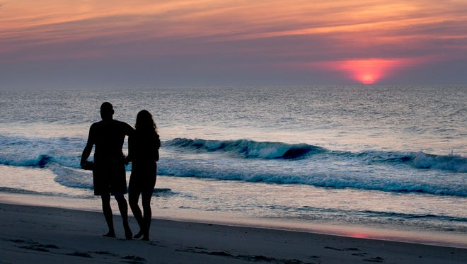 Bill and Justina White of Seaside Park walk along the beach to start of their day.