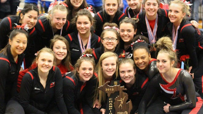 The Canton Chiefs happily pose with their trophy after winning Saturday's MHSAA team regional at Plymouth High School.