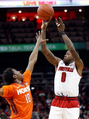 Louisville's Terry Rozier takes a shot over Virginia Tech's Justin Bibbs.  Rosier had 16 points. Jan. 13, 2015