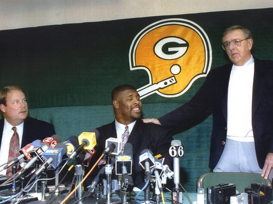 Mike Holmgren, Reggie White and Ron Wolf answer media questions after White signed a free-agent contract with the Packers on April 6, 1993.