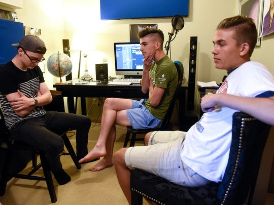 Guytano band members Isaac Hesse, left, Grant Hamilton, center, and Eddie Hamilton talk about their music during an interview Thursday, June 8, in Sartell.