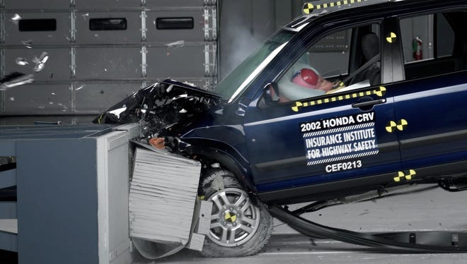 A 2002 Honda CR-V is crash-tested by the  Insurance Institute for Highway Safety. The 2002 CR-V is among millions of models that have been recalled previously for a Takata airbag defect that can send deadly shrapnel into face, chest of people sitting in front of the bag.