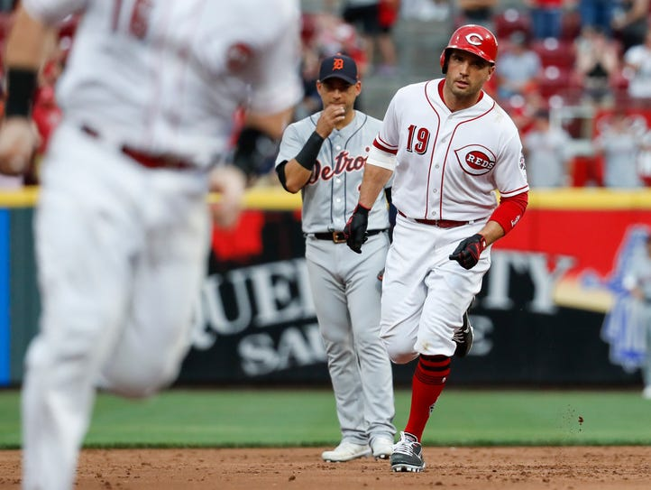 Cincinnati Reds' Joey Votto (19) runs the bases after