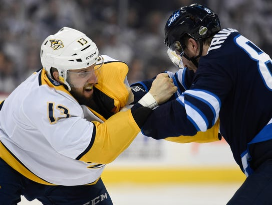 Nashville Predators center Nick Bonino (13) fights