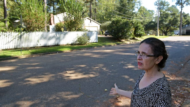 Carmel Lopez-Lampton stands in the street beside her home in Jackson. Lopez-Lampton believes the neighborhood association from the adjacent neighborhood plans to install a gated entrance fence near her property line.