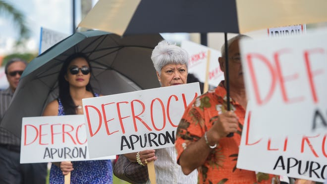 Members and supporters of the Laity Forward Movement and Concerned Catholics of Guam partake in their last picket against Archbishop Anthony Apuron, in order to give the Vatican space for a decision on his removal from the archdiocese at the Dulce Nombre de Maria Cathedral-Basilica in Hagåtña on July 9, 2017.