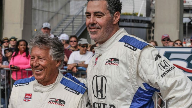 Adam Carolla, right, and Mario Andretti pose on the red carpet before Sunday's Indy 500.