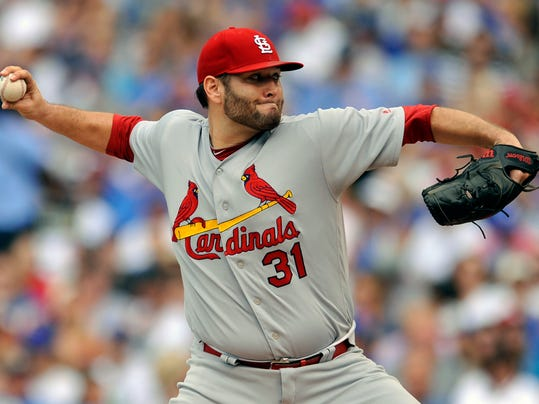 FILE - In this Sept. 17, 2017, file photo, St. Louis Cardinals starter Lance Lynn delivers a pitch during the first inning of a baseball game against the Chicago Cubs in Chicago. The Minnesota Twins have finalized a $12 million, one-year contract with right-hander Lynn, another patient, low-risk move toward strengthening their pitching staff. The deal was announced by the Twins on Monday, March 12, 2018. (AP Photo/Paul Beaty, File)
