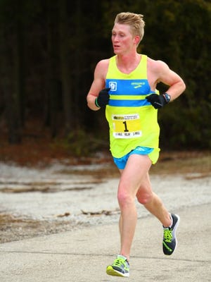 John Dewitt broke his own Two Rivers 10-Mile course record in impressive fashion with a time of 50:09 Sunday to win the overall title.