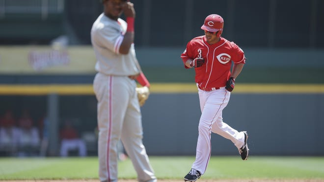 Cincinnati Reds' Ivan De Jesus (3) rounds the bases after hitting a three-run home run against the Philadelphia Phillies during the first inning of a baseball game, Wednesday, June 10, 2015, in Cincinnati. (AP Photo/John Minchillo)