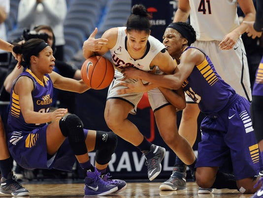 East Carolina's Abria Trice, left, UConn's Gabby Williams, center, and East Carolina's Jada Payne fight for the ball during the second half of an NCAA college basketball game, Wednesday, Jan. 28, 2015, in Hartford, Conn.  UConn won 87-32. (AP Photo/Jessica Hill)
