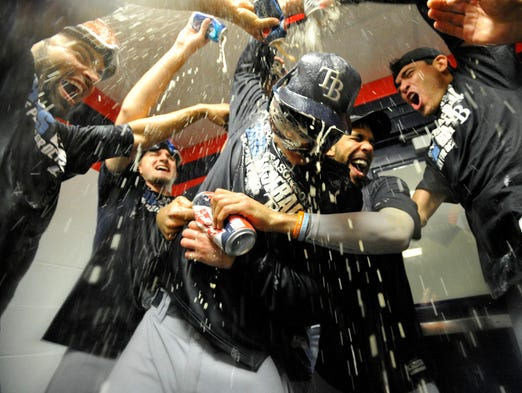 Tampa Bay Rays pitcher Alex Cobb, center, celebrates with teammates after defeating the Cleveland Indians at Progressive Field.