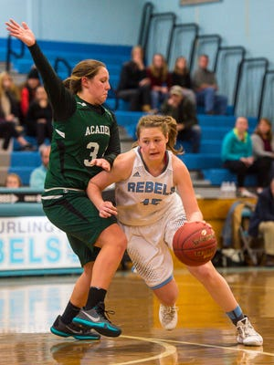South Burlington's Grace Hoehl, right, is defended St. Johnsbury Academy's Josie Choiniere in South Burlington on Friday, January 6, 2017.