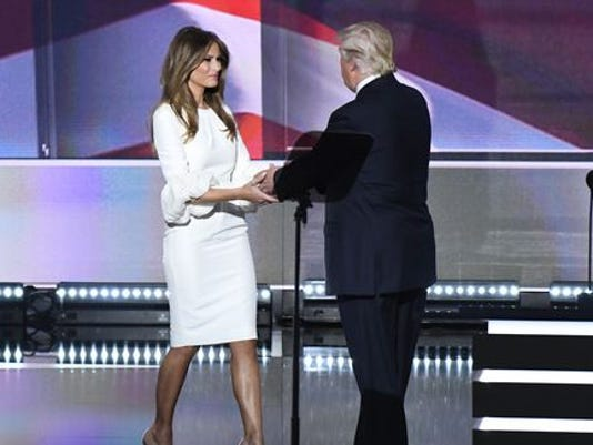 636045240739679369-The-Donald-greets-wife.JPG