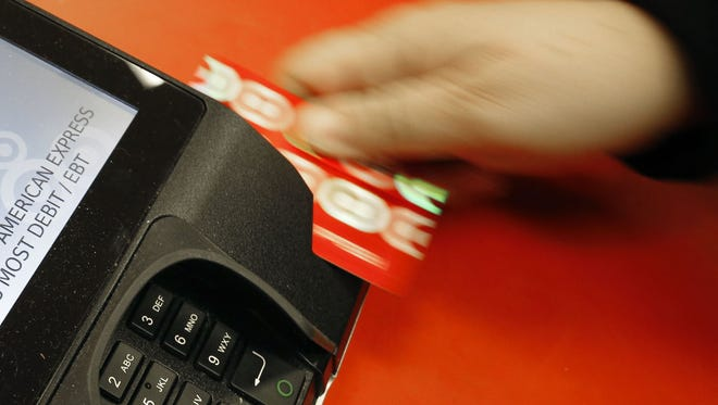 The federal government busted an alleged identity theft ring involving people who stole information used to open fake credit cards and went on shopping sprees.