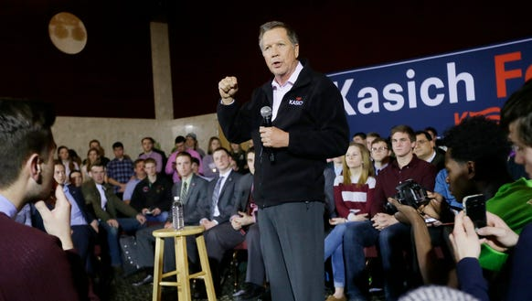 John Kasich, addresses supporters during a campaign
