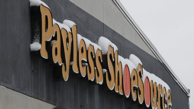 The Payless Shoe Source sign was topped with snow in Shively.Jan. 10, 2015