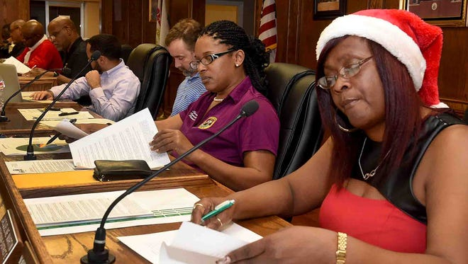 Mayor Pro Tempore Jackie Martin, far right, has the Christmas spirit as she attends the monthly meeting of the Opelousas Board of Aldermen Thursday.