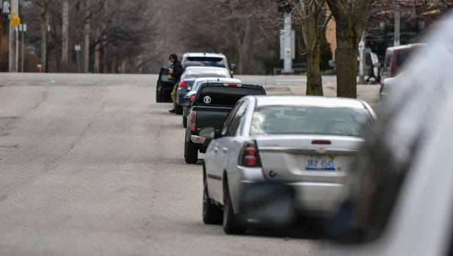 Vehicles parked along S. Hayford Avenue near E.  Michigan Avenue Tuesday, April 10, 2018.   parked along S. Hayford Avenue near East Michigan Avenue Tuesday, April 10, 2018.