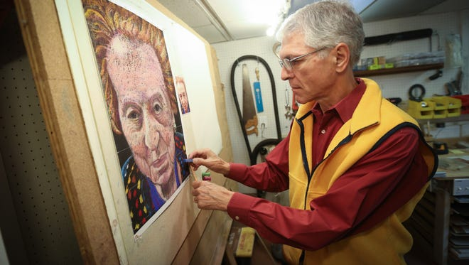 Paul Simon, a recently retired scientist, works on a current pastel  portrait of woman whom he met through Jewish Family Services where he volunteers to driving seniors to needed places.