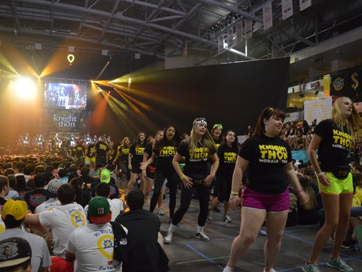 The Morale Team dances during opening ceremonies before