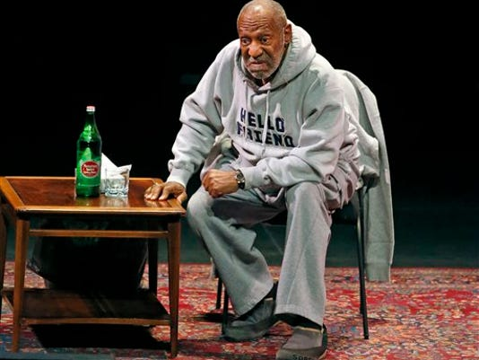 In this Jan. 17, 2015 file photo, comedian Bill Cosby performs at the Buell Theater in Denver.