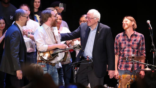 Former presidential candidate Sen. Bernie Sanders, center, and DNC Chair Tom Perez, far left, greeted members of the band Relic following his speech at the Louisville Palace.  Apr. 18, 2017