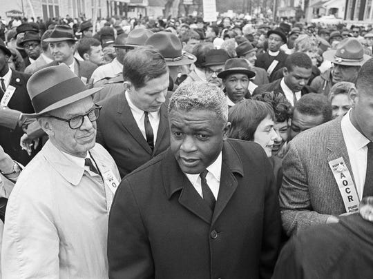 In this March 5, 1964 file photo, former baseball star Jackie Robinson, center, appears with demonstrators in a civil rights march on the capitol in Frankfort, Ky.
