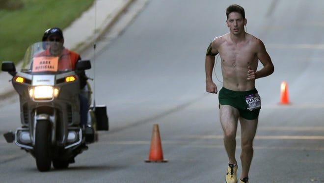 Mason Grundy runs in the Community First Fox Cities Marathon on Sunday, September 20, 2015, in Combined Locks, Wis.