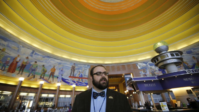 Jason French speaks about the collection of historical artifacts, significant to Cincinnati, housed at the Cincinnati Museum Center at Union Terminal in Cincinnati on Thursday, Oct. 29, 2015.