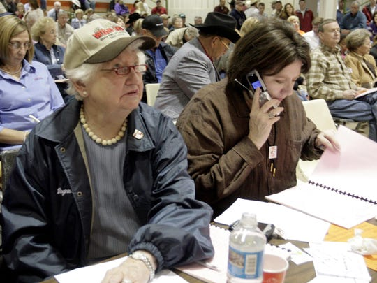 Virginia Shehee and her daughter Margaret Shehee Cole look through the auction program and bid on livestock at the State Fair of Louisiana Junior Livestock Show in 2006.