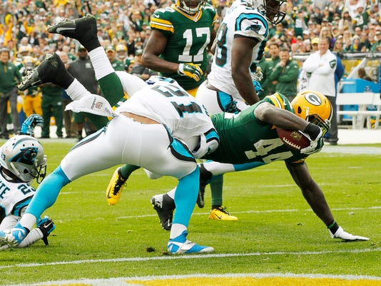 Green Bay Packers' James Starks (44) gets past Carolina Panthers' Thomas DeCoud for a touchdown run during the first half of an NFL football game Sunday, Oct. 19, 2014, in Green Bay, Wis. (AP Photo/Mike Roemer)
