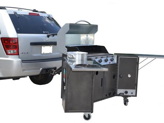GoGalley's outdoor kitchens fasten to the tow hitch on the back of the vehicle.