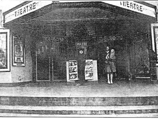 The Evans Theater on the east side of the square was Mountain Home's first movie theater. It opened in the mid-1930s and could seat 250 moviegoers. This photo probably was taken during the early 1940s since the movie showing was John Wayne's Flying Tigers, which was released in 1942.
