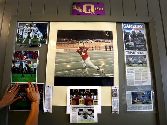 A wall at Pollard's Restaurant showcasing the athletic achievements of Tony Pollard is updated with new art.