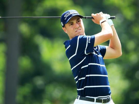 Justin Thomas plays his shot from the 18th tee during the first round of the BMW Championship at Medinah Country Club.